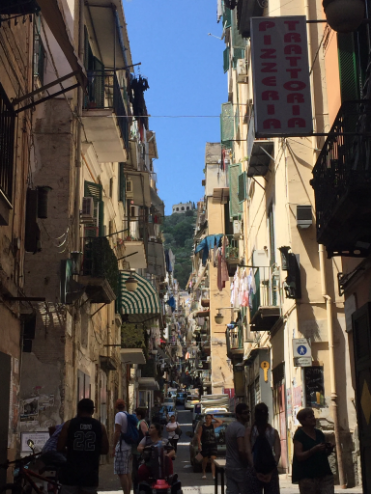 "This street, Spaccanapoli, translates to ""Naples splitter"""