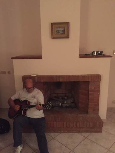 Angelo playing for the WRiT writers after dinner
